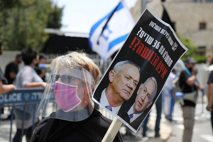 People protest against Netanyahu being prime minister outside his residence in Jerusalem, May 3, 2020.