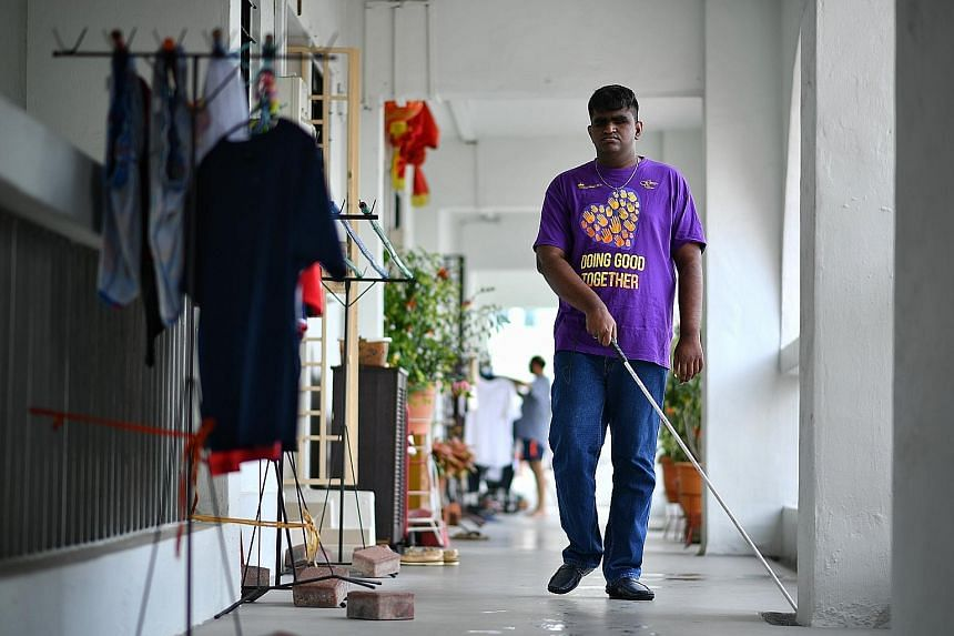 Mr John Danesh Krishnan, 21, who is blind, outside his home in Jurong. He had eye cancer and lost his sight at the age of two. He attended the School for the Visually Impaired, now known as the Lighthouse School, where he learnt Braille. It was also