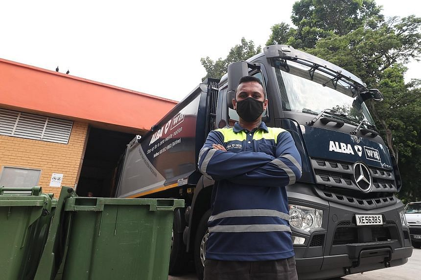 Garbage truck driver Kalaiarasan Tamilchelvan has been working three hours longer than usual these days. Every day, he drives to 25 neighbourhoods within the Jurong region to collect waste and makes about five trips to the waste collection facility i