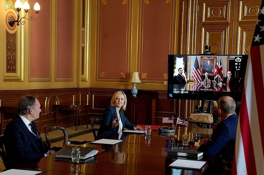A handout photo from 10 Downing Street showing British international trade secretary Liz Truss during a video conference call with US Trade Representative Robert Lighthizer, in the Foreign Office in London on Tuesday. The formal negotiations on a fre