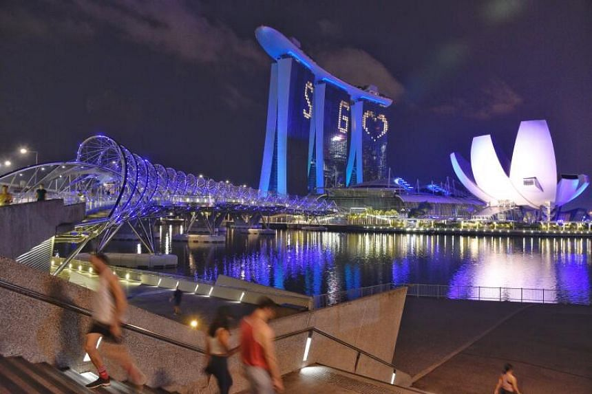 The Helix Bridge lit up in blue on May 7, 2020.