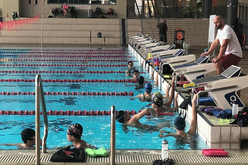 American Doug Djang, 35, sees positives in the enforced Covid circuit breaker, in that it allows student-athletes to reflect on their goals and process. Swimmers Julia Lium and Ritchie Oh say their stroke efficiency has improved under his guidance.