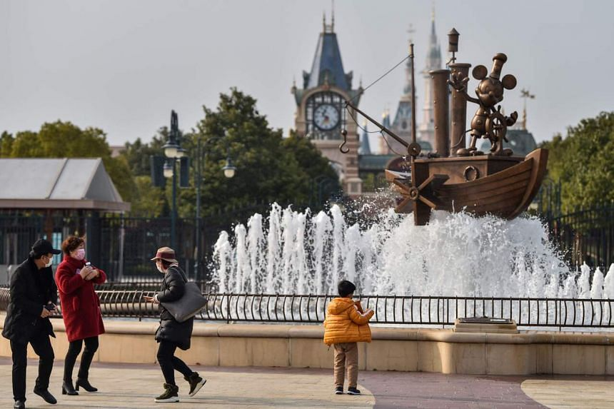 The theme park is implementing safety measures, including limiting visitors to one-third of the normal capacity of 80,000.
