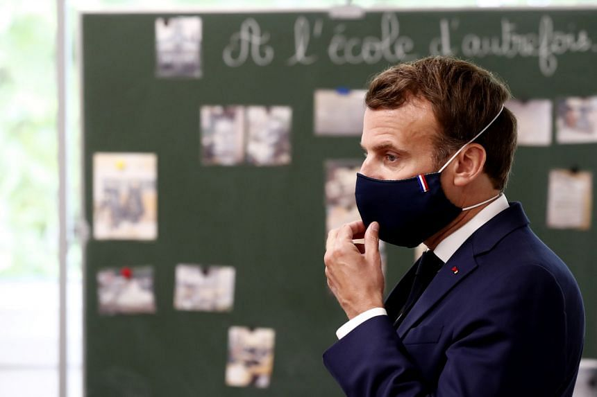 French President Emmanuel Macron wearing a mask during a visit to an elementary school in Poissy, France, on May 5, 2020.