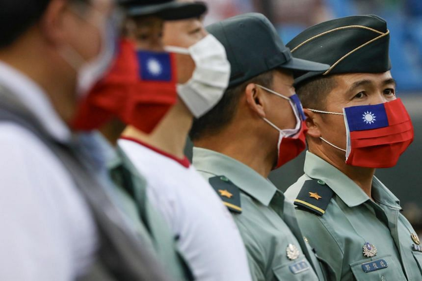 Army representatives are seen at the opening of a baseball game in Taiwan on May 7, 2020.