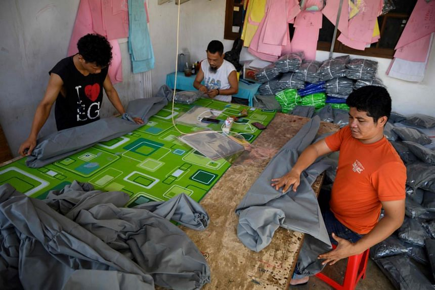 Garment industry employees help make personal protective equipment in Jakarta on April 7, 2020.