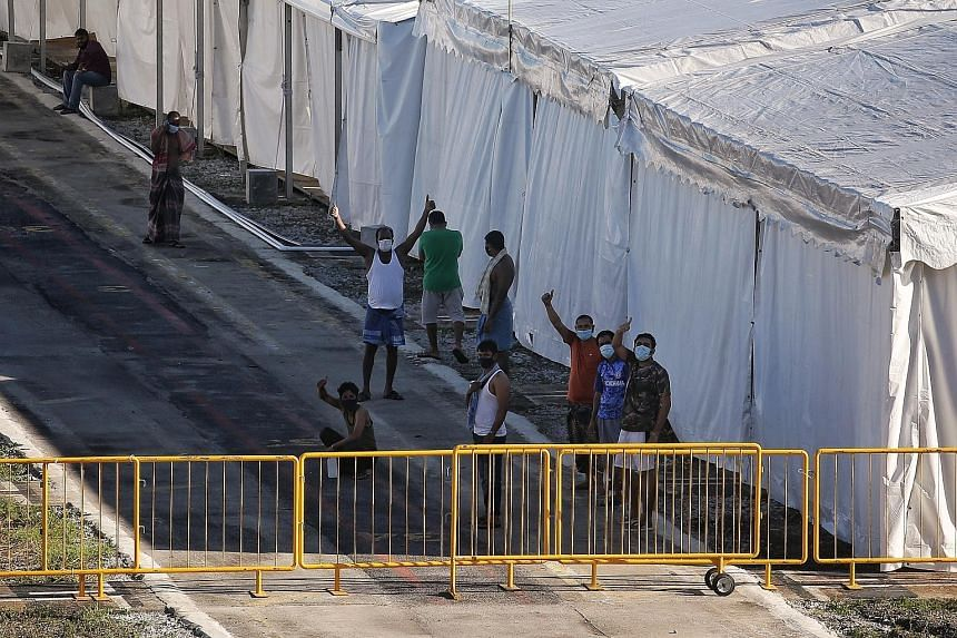 Migrant workers seen at the Tanjong Pagar Terminal facility. The site includes tentage with beds and floating accommodation to house patients who are currently recovering or who have recovered from Covid-19. ST PHOTO: KEVIN LIM