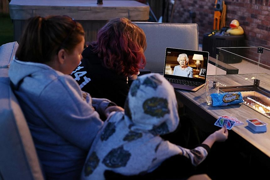 "A family in Britain watching Queen Elizabeth II making her televised address to the nation on Friday, at the same time that her father, King George VI, gave a radio address marking VE Day in 1945. ""Never give up, never despair - that was the message"