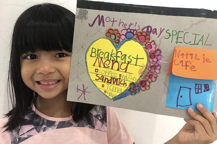 """Five-year-old Natalie Rai (above) is treating her mum to a special breakfast menu at """"Natalie Cafe"""", where she will help prepare her mum's choice of sandwich and drink."""