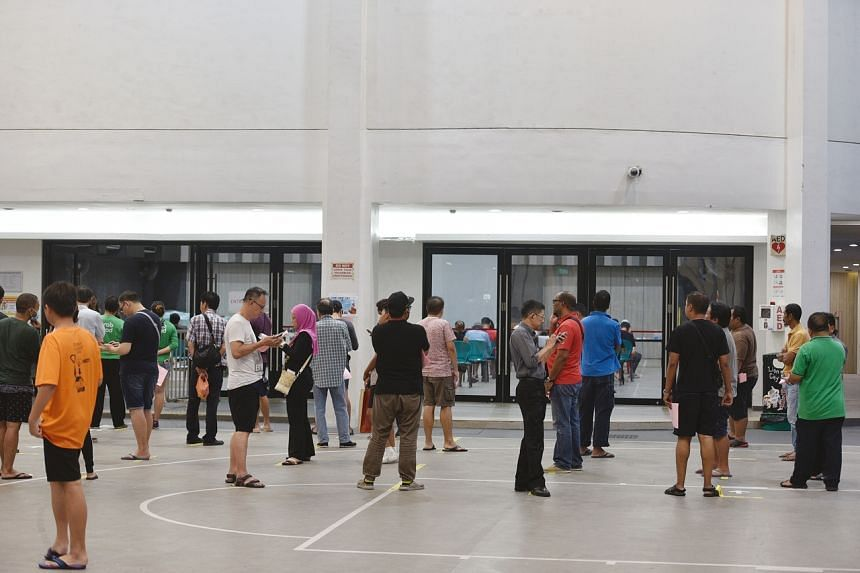 Singaporeans waiting to apply for the Temporary Relief Fund in April 2020.