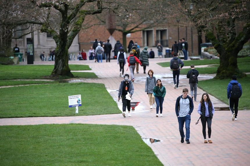 Students at the University of Washington campus for the last day of in-person classes, on March 6, 2020.