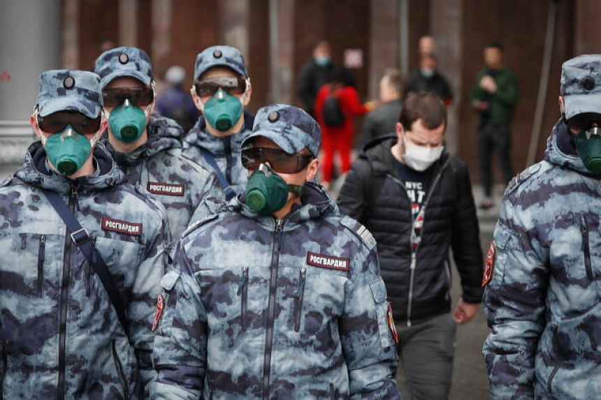 Russian National Guards wearing protective masks while patrolling Moscow's Red Square on May 9, 2020.