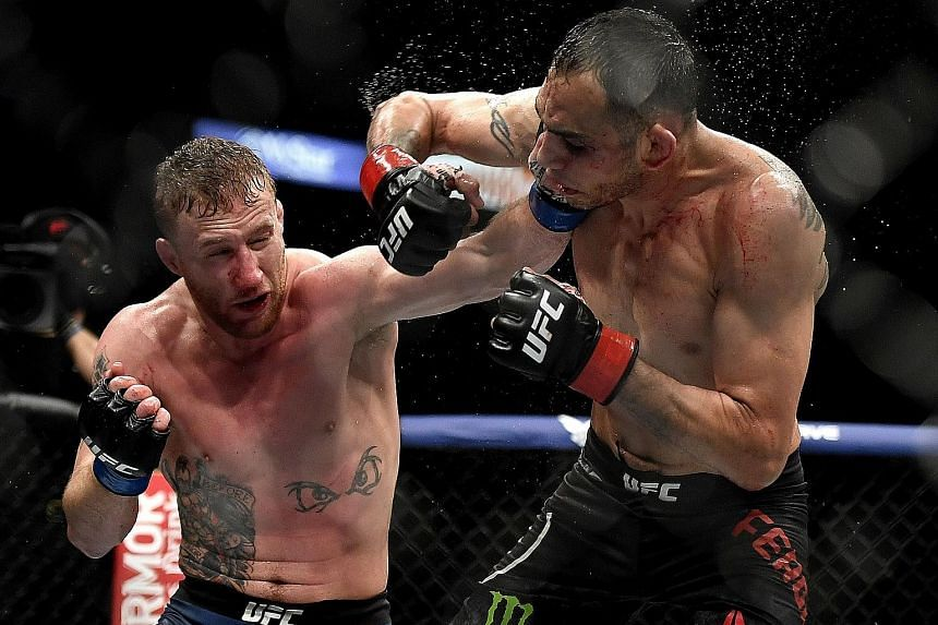 Justin Gaethje (left) hurting Tony Ferguson en route to a technical knockout victory in the fifth round of their UFC 249 lightweight bout on Saturday.