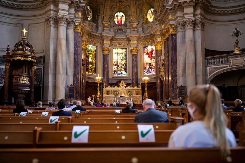 Social distancing at the Berlin Cathedral yesterday. The spike in cases has raised concerns that the outbreak could slip out of control.