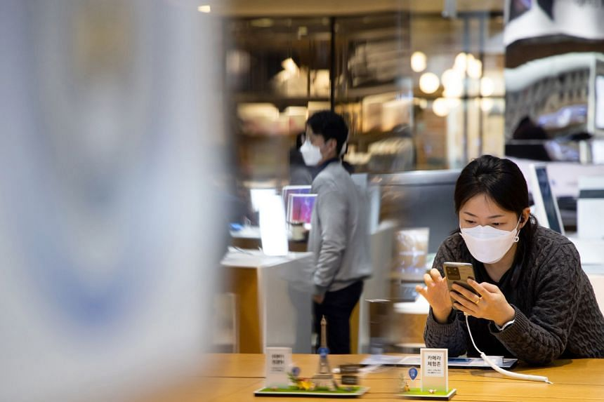 A customer at Samsung's flagship store in Seoul in March.