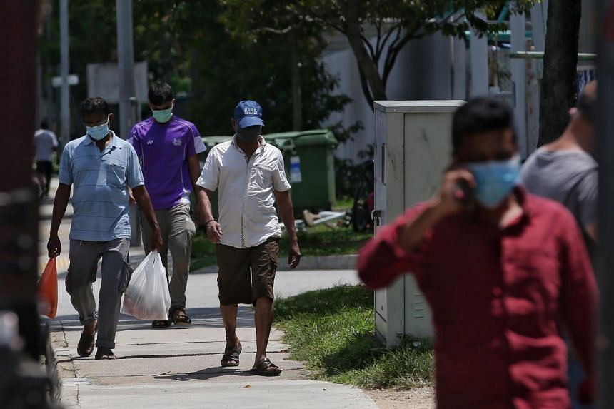 Foreign workers make their way to an eating house at Kian Teck Avenue on April 16, 2020.