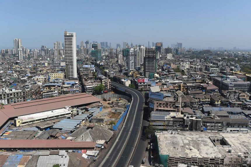 An aerial view shows a deserted JJ bridge against the backdrop of city's skyline in Mumbai on March 22, 2020.