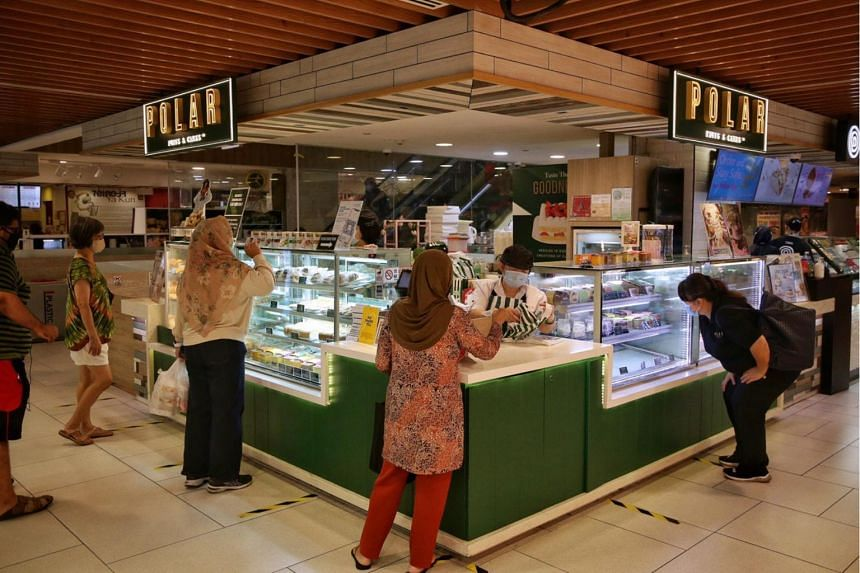 Shoppers making purchases at Polar Puffs and Cakes on May 12, 2020.