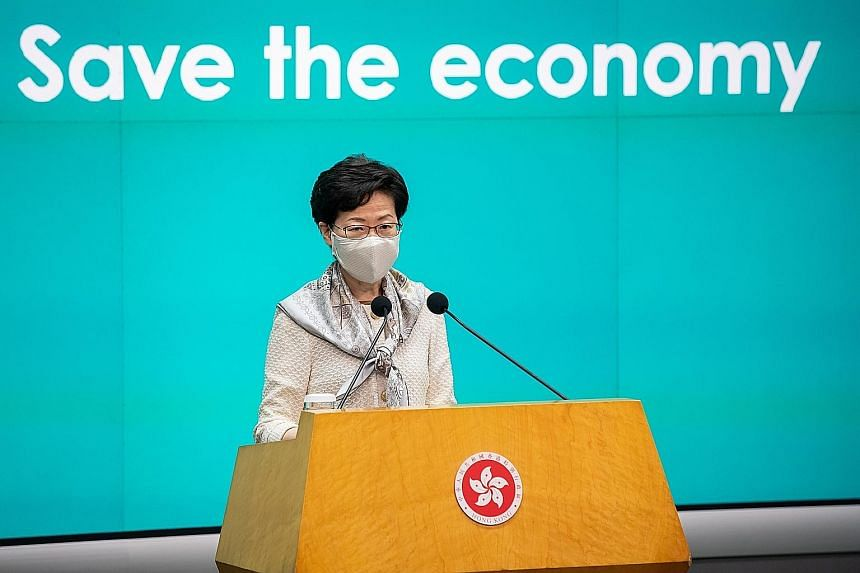 "Chief Executive Carrie Lam at a news conference in Hong Kong yesterday. She has said it is necessary for school curriculum reforms that would foster a ""national identity"", a move which could prompt further protests."