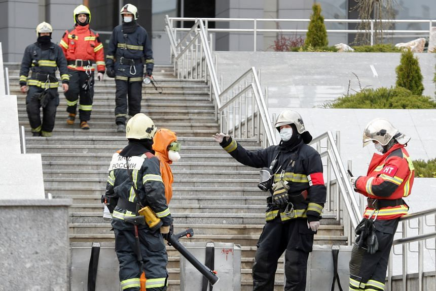 Emergency specialists work on the site of a fire at a hospital in Saint Petersburg on May 12, 2020.