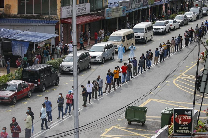 Residents around Raja Bot market at Kampong Bharu line up to register for Covid-19 screenings in Kuala Lumpur, Malaysia, on May 7, 2020.