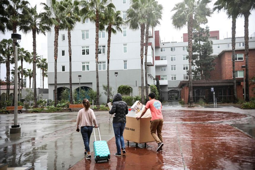 Students move their belongings from dormitories at San Diego State University in California on March 18, 2020.