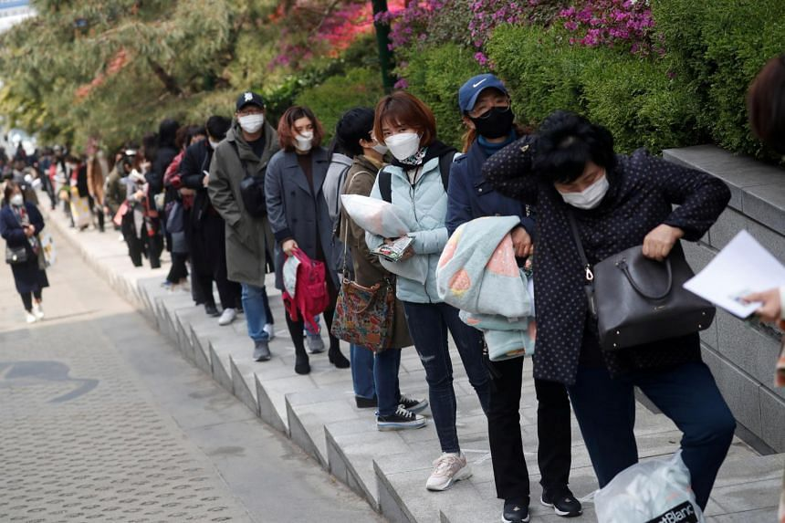 Job seekers queueing to take an exam in Seoul, South Korea, on April 25, 2020.