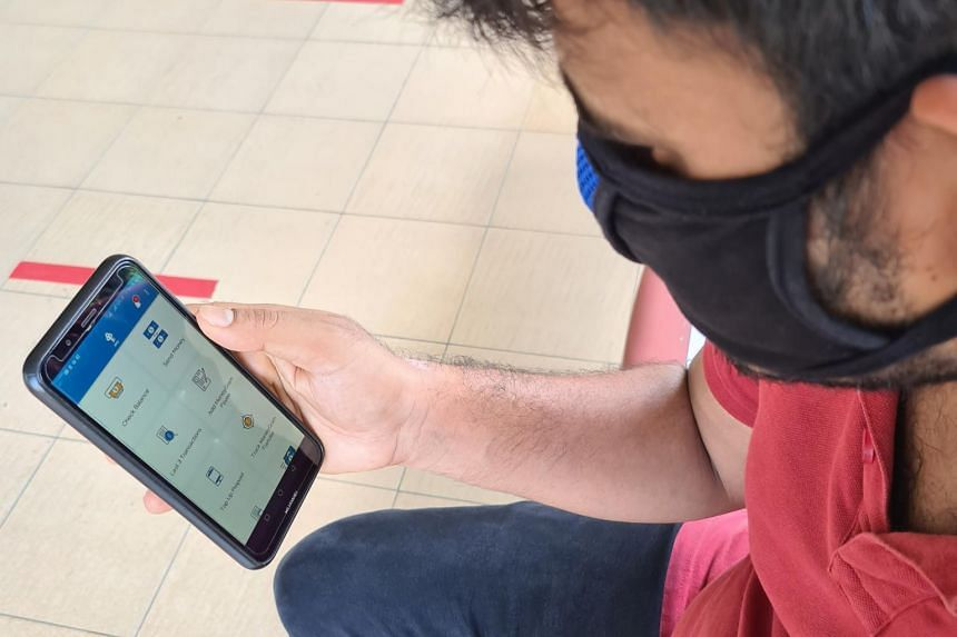 A migrant worker using POSB's contactless banking service.