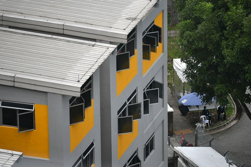 Some 750 migrant workers linked to dorms are among the new cases reported on Thursday.
