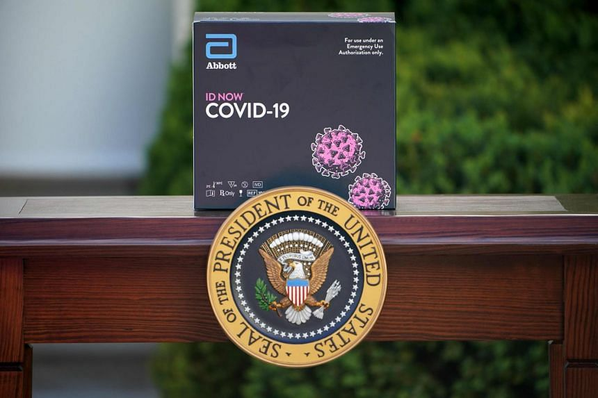 A box containing a 5-minute coronavirus test from Abbott Laboratories is seen on March 30, 2020.