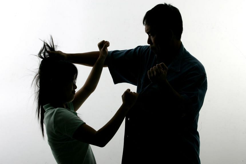 A posed photo to illustrate family violence.