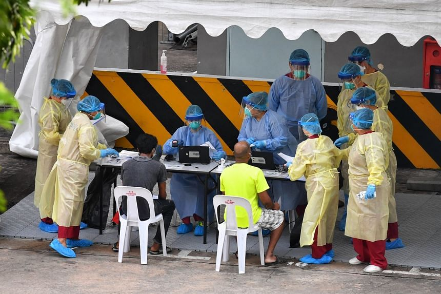 Foreign workers undergoing medical examination at Toh Guan Dormitory, on May 2, 2020.