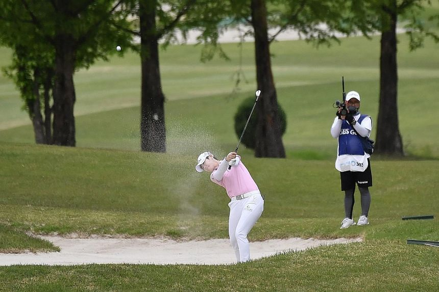 Park Sung-hyun blasting out of a bunker on the 18th hole during the first round of the KLPGA Championship at Lakewood Country Club in Yangju, South Korea. She finished her round with a 73, six behind the pace as the world's third-ranked player and ot