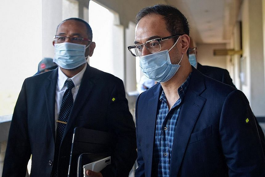 A sessions court in Kuala Lumpur said the dropping of charges against Riza Aziz (right) yesterday did not amount to an acquittal.