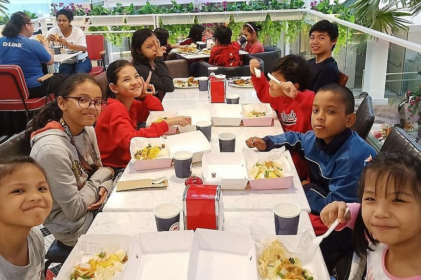 The Straits Times School Pocket Money Fund beneficiaries at a charity night in celebration of Perennial Real Estate Holdings' 10th anniversary and The Capitol Kempinski Hotel's first anniversary on Dec 6 last year. About 10,000 students from low-inco