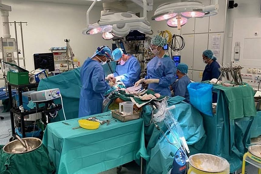 Doctors performing heart bypass surgery at a hospital here last week. Since the circuit breaker period started on April 7, only essential healthcare services have been allowed to continue.