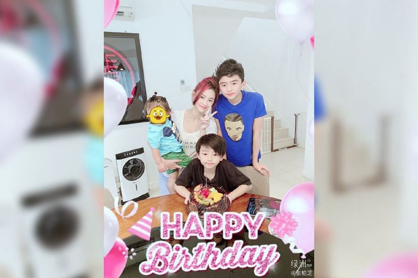 Cecilia Cheung with her three sons as they celebrate Quintus' 10th birthday.