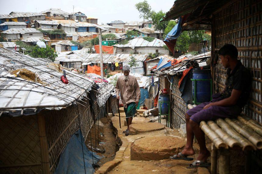 A Rohingya refugee walks in Cox's Bazar, Bangladesh, on March 7, 2019.