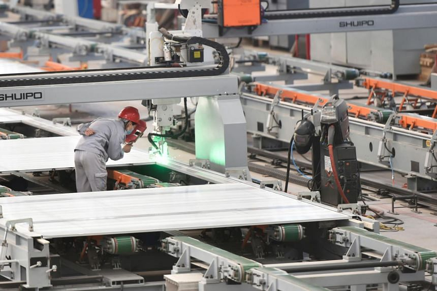 China's Factory Output Posts First Increase For 2020 But Consumption Still Weak