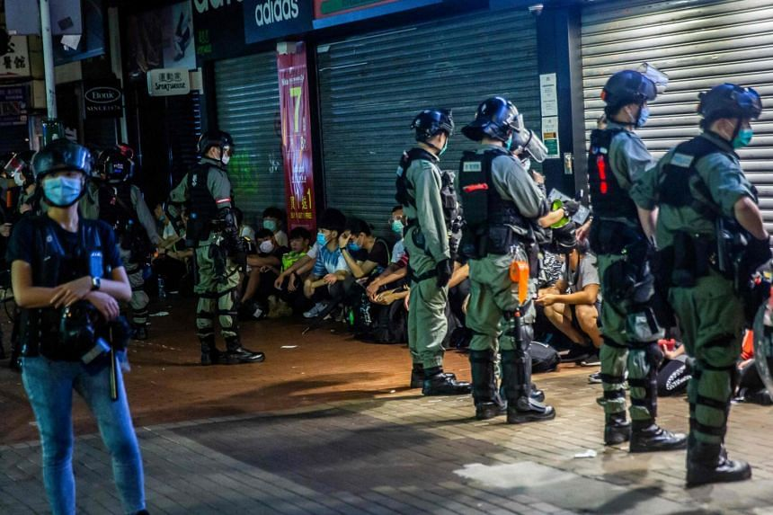 Police detain a group of people during a pro-democracy protest in Hong Kong on May 10, 2020.