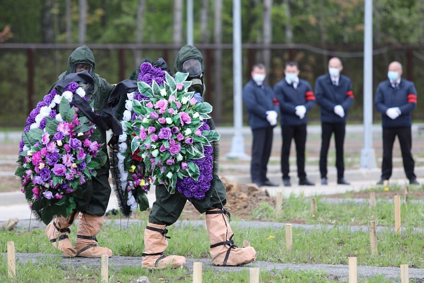 The burial of a Covid-19 victim at a cemetery on the outskirts of Moscow on May 15, 2020.