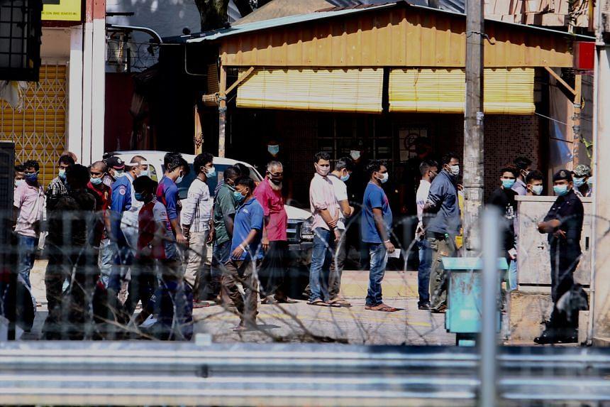 An immigration enforcement exercise at Pasar Borong Kuala Lumpur.