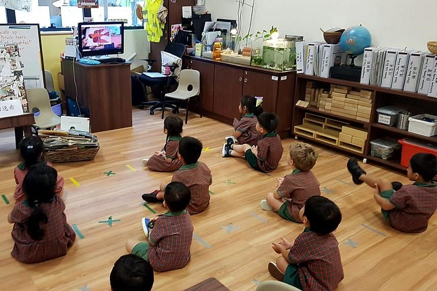 Children preparing for home-based learning, while sitting 1m apart, at an EtonHouse Pre-School in Mountbatten Road before the circuit breaker.