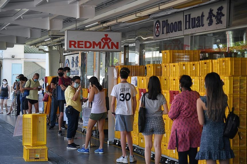 Long queues at the Phoon Huat store (above) in Toa Payoh last Thursday. With more customers stocking up on baking supplies, the shop has run out of some ingredients.