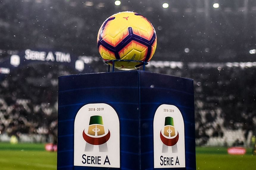 An Italian Serie A official soccer ball and logo are pictured on May 13, 2020, before a Juventus versus Parma match.