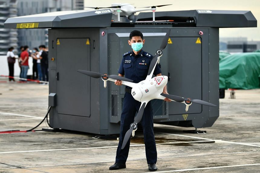 DSP Sum Tuck Meng with the drone and drone box.