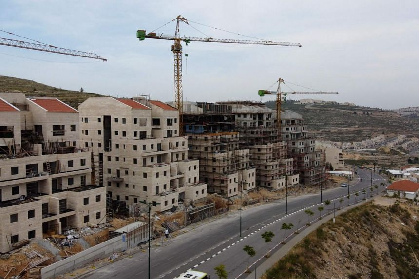 Construction works in the Jewish settlement of Givat Zeev, near the Israeli-occupied West Bank city of Ramallah.