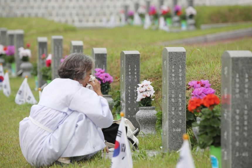 A woman at a national cemetery honouring people killed during the 1980 Gwangju Uprising in South Korea, on May 18, 2020.