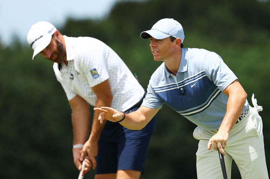 Rory McIlroy (right) and Dustin Johnson at the Driving Relief charity match in Juno Beach, Florida, on May 17, 2020.