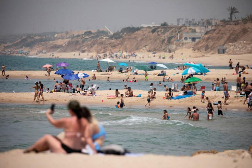 People are streaming back to beaches, parks and streets after coronavirus restrictions eased.
